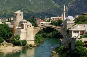 Walk across Stari Most Bridge (Old Bridge), Mostar, Bosnia and Herzegovina