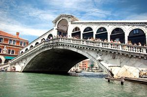 Walk across Rialto Bridge, Venice, Italy