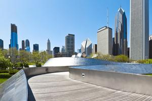Walk across BP Bridge in Millennium Park, Chicago