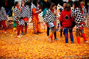 Attend Ivrea Carnevale (Battle of the Oranges), Ivrea, Italy