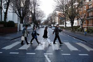 Walk in the footsteps of The Beatles, crossing Abbey Road, London, England